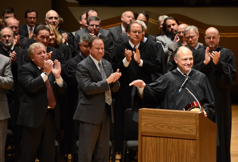 Court of Appeals Judge Russell Carparelli is applauded during a ceremony at the Supreme Court Assembly of Lawyers on Oct. 29, 2012, after accepting the Chair's Award for Civility in Law from the American Bar Association Section of Dispute Resolution.