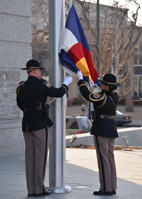 A Colorado State Patrol color guard raised the American and Colorado flags for the first time during a Jan. 14, 2013, celebration marking the opening of the Ralph L. Carr Colorado Judicial Center.