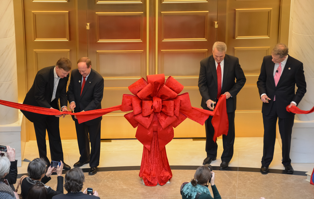 From left to right, Governor John Hickenlooper, Attorney General John Suthers, former Governor Bill Ritter, and Chief Justice Michael L. Bender cut the ribbon marking the opening of the Ralph L. Carr Colorado Judicial Center during a Jan. 14, 2013, ceremony.