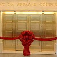 A ribbon hanging across the entrance to the first-floor Court of Appeals courtroom at the Ralph L. Carr Colorado Judicial Center before a Jan. 14, 2013, ceremony marking the opening of the building.