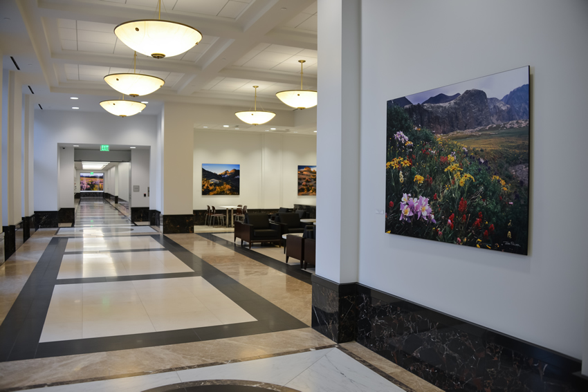 A commons area with photographs by John Fielder on the ground floor of the Ralph L. Carr Colorado Judicial Center.