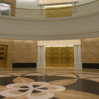 A view toward the doors to the first-floor Court of Appeals courtroom, and the stone columbine flower inlaid in the atrium floor.